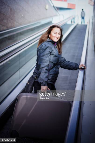 A young girl leaving to an airport with suitcase