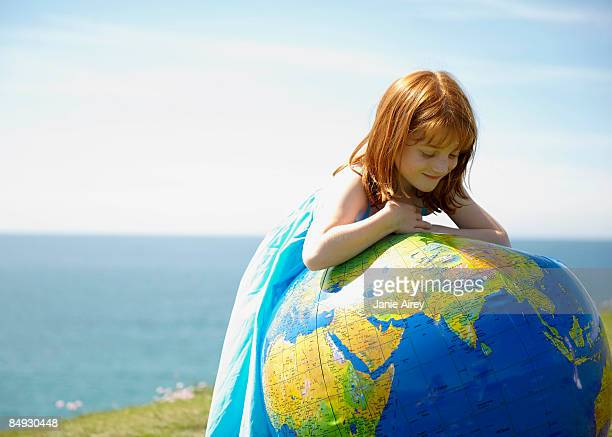 Young girl looking at inflatable globe