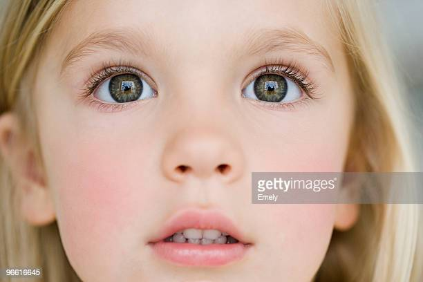 young girl looking dazzled