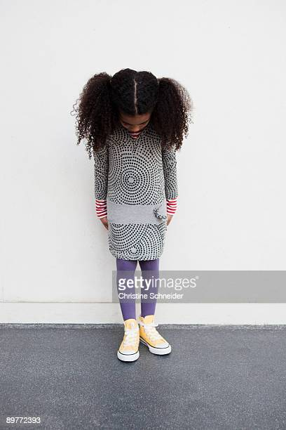 young girl looking down her legs