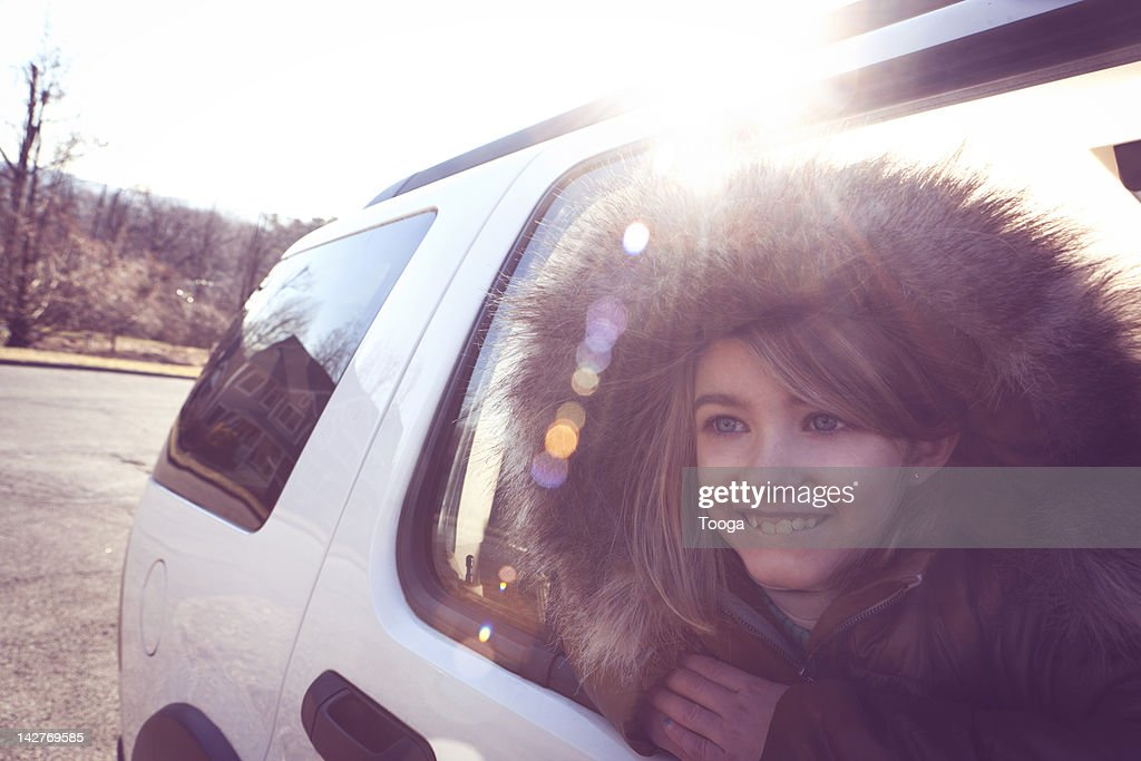 young girl looking out of car window stock photo getty