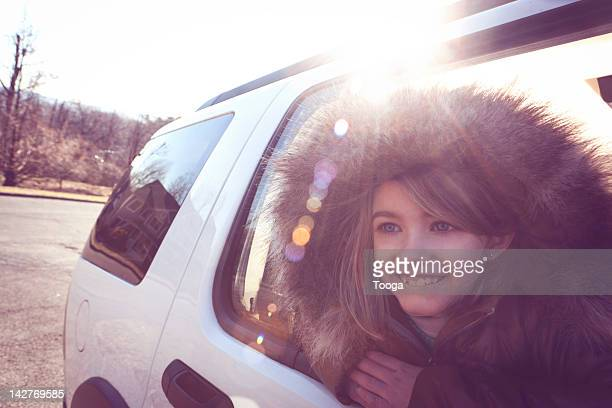 Young girl looking out of car window