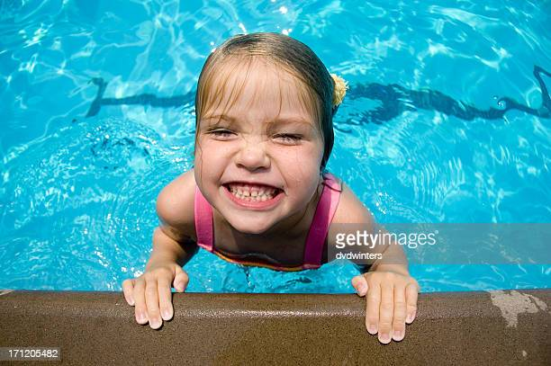 Young girl looking out of swimming pool