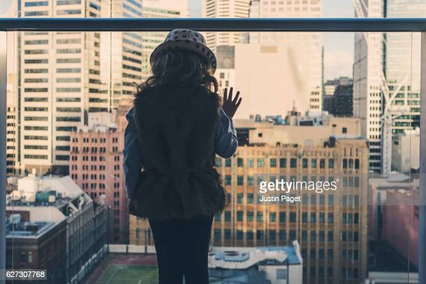 Young Girl Looking out over city