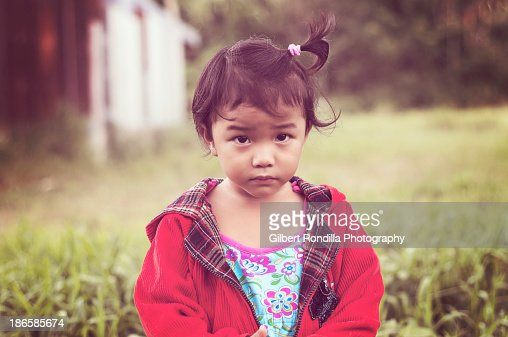 Young girl looking sad : Stock Photo