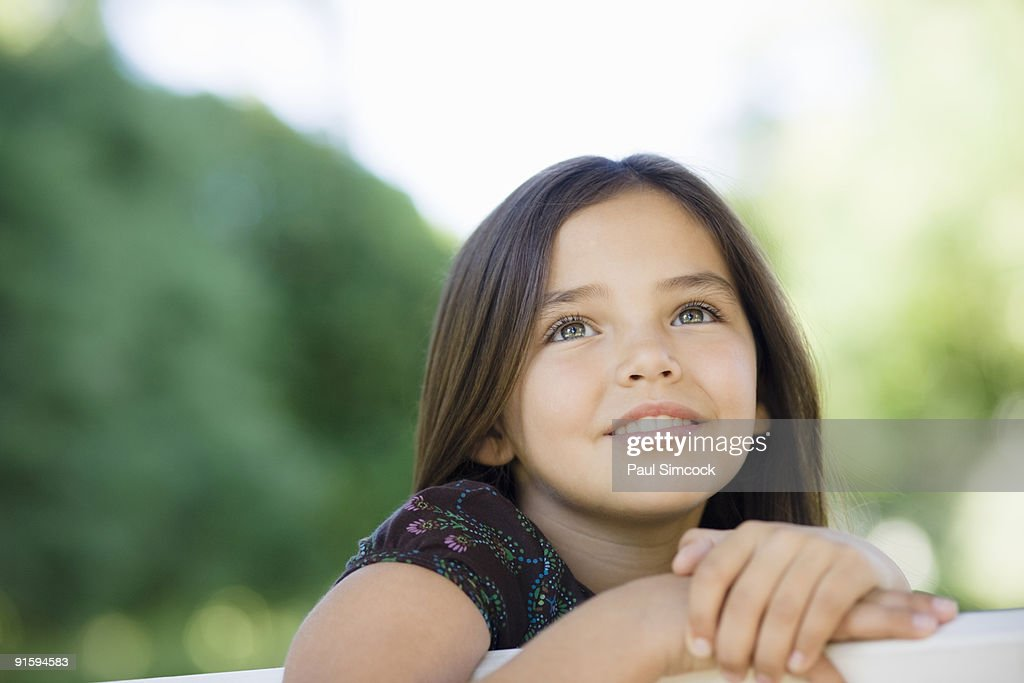 Young Girl Looking Thoughtful : Stock Photo