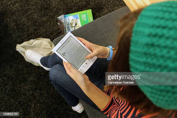 A young girl looks at a Sony ebook at the Frankfurt Book Fair on October 10 2012 in Frankfurt Germany The Frankfurt Book Fair is the largest in the...