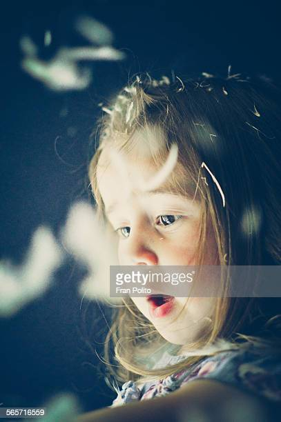 A young girl looks in wonder
