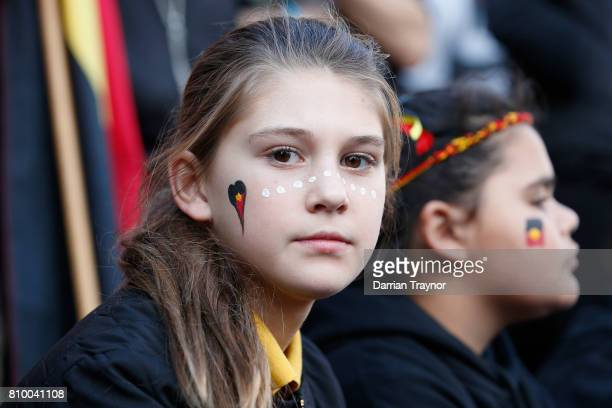 A young girl looks on during the 2017 NAIDOC March on July 7 2017 in Melbourne Australia The march was organised to call for a day of mourning and to...