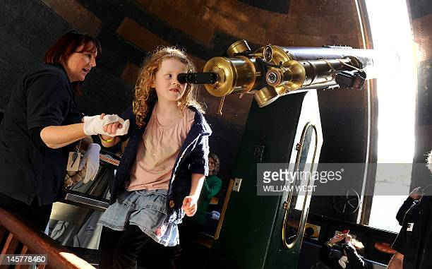 A young girl looks through a telescope to watch Venus pass in front of the Sun at the historic Sydney Observatory where a sellout crowd of 1500...
