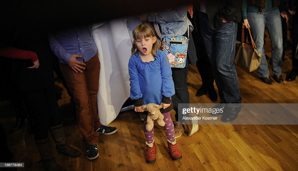 A young girl looks tired during the German Social Democrats (SPD) state election party on January 20, 2013 in Hanover, Germany. The elections are being seen by many as a bellwether for national elections scheduled for later this year.
