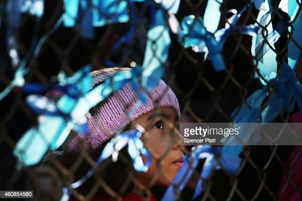 A young girl looks up at memorial ribbons outside of Christ Tabernacle Church for the funeral of slain New York City Police Officer Rafael Ramos one...