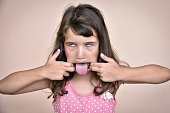 Cute young girl making a funny face
