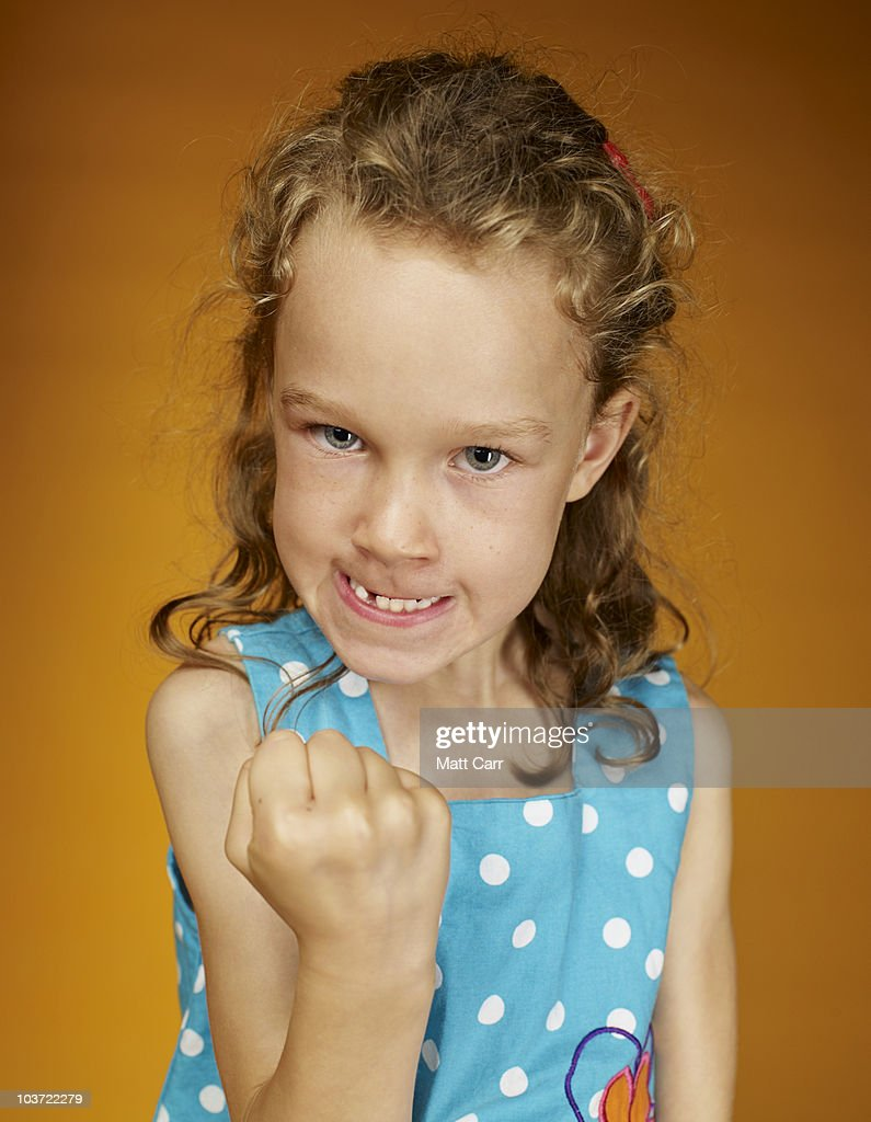 Young girl making an angry face : Stock Photo