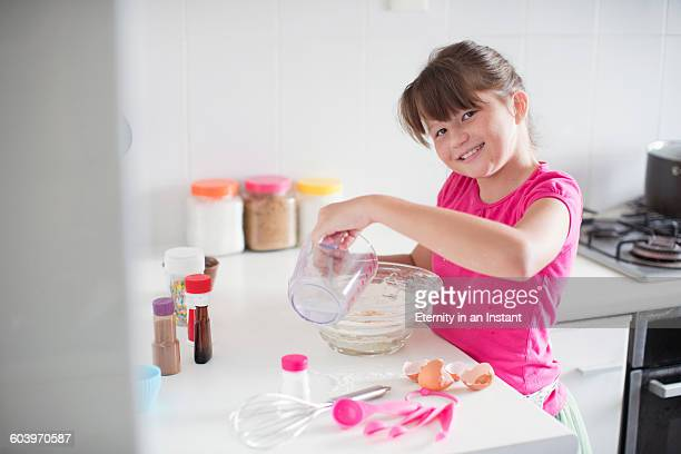 Young girl making cookies at home