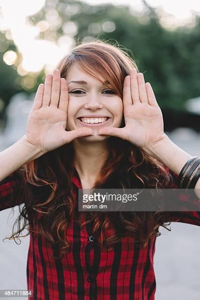 Young girl making finger frame