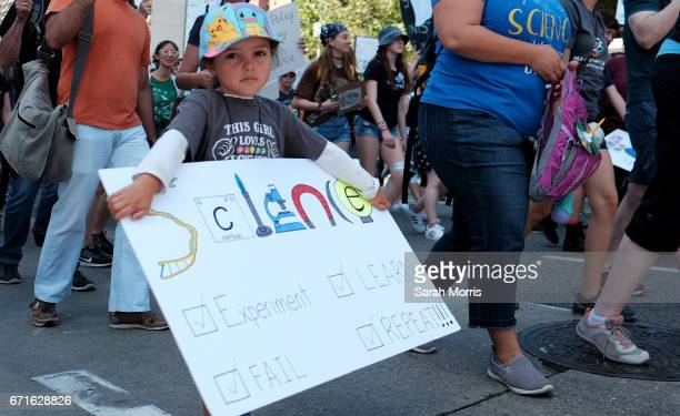 A young girl marches with scientists and supporters through downtown Los Angeles in a March for Science on April 22 2017 in Los Angeles California...
