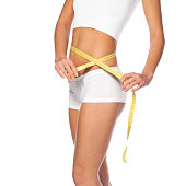 young girl measuring perfect shape of beautiful hips isolated white