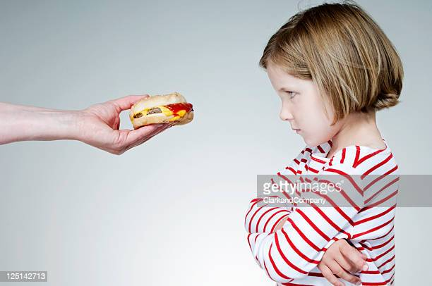 Young Girl Not Happy About Eating a Hamburger or Beefburger