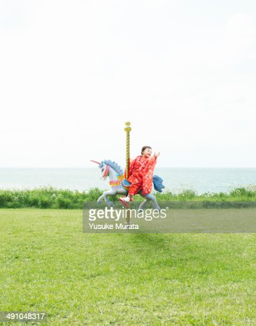 Young girl on a merry-go-round : Foto de stock