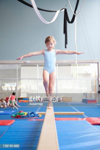 Young girl on balance beam