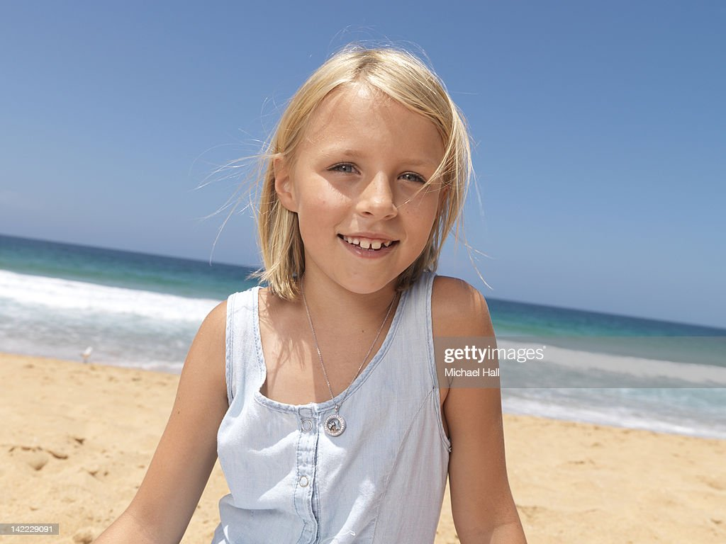 Young girl on beach : Stock Photo