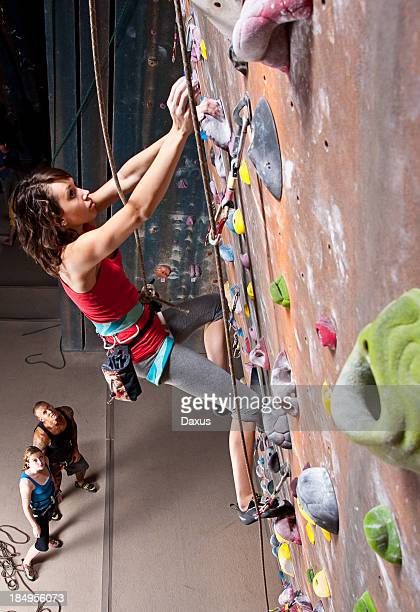 Young girl on interior climbing wall