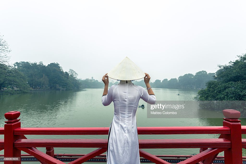 Young girl on red bridge, Hoan Kiem lake, Hanoi