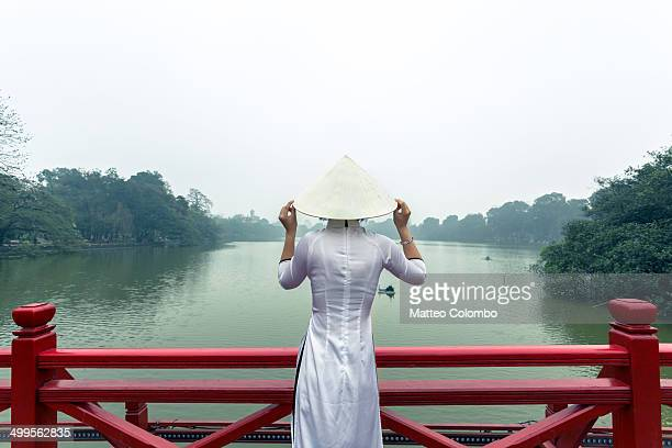 Young girl on red bridge, Hoan Kiem lake, Hanoi