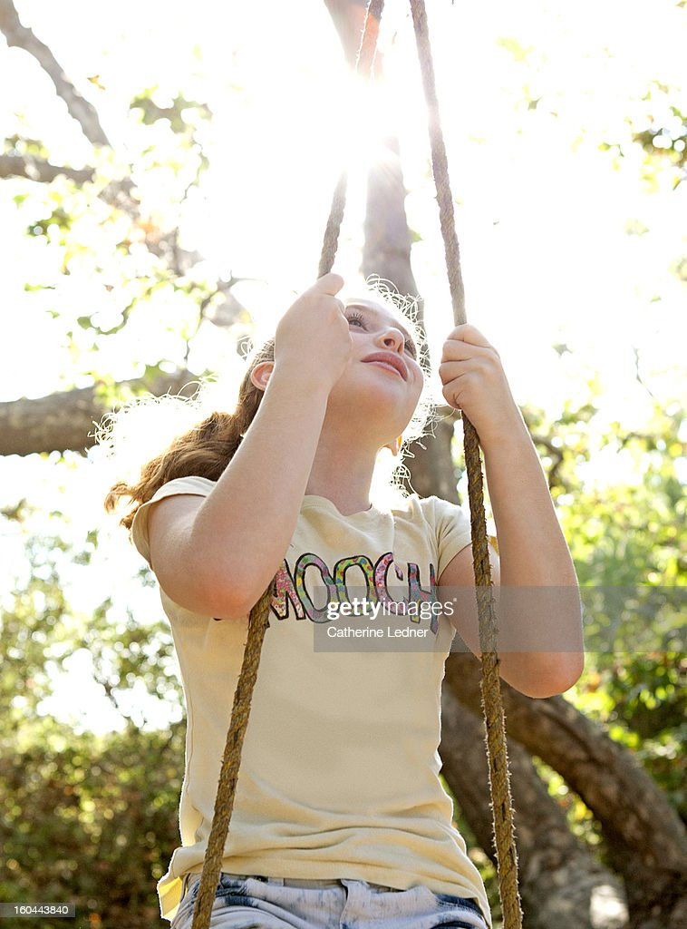 Young Girl on Swing Looking Up : Stock Photo