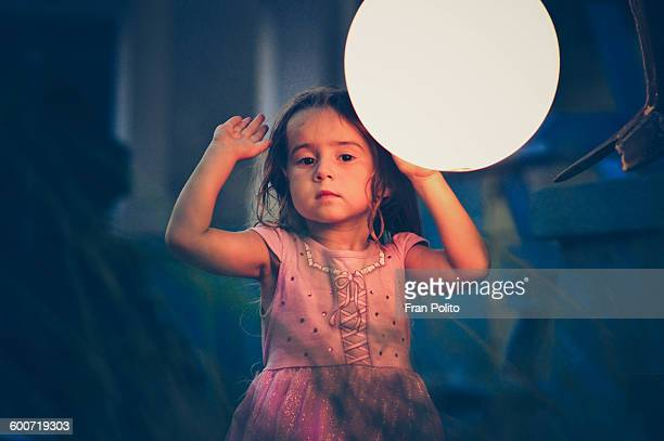 Young girl outside on a summer night.