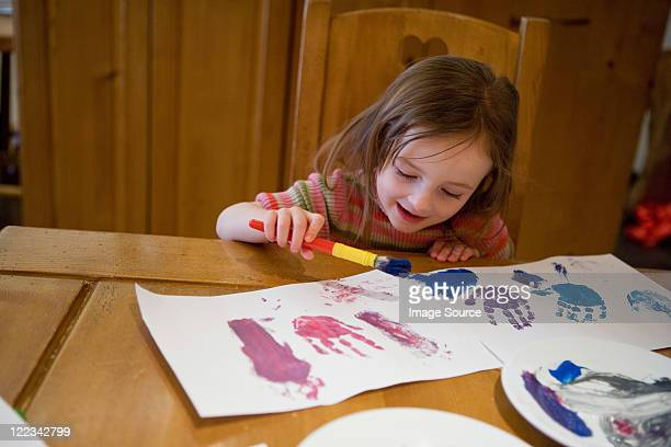 Young girl painting pictures