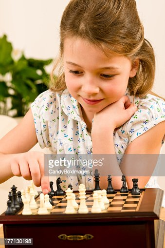 Young girl play chess cute smile : Stock Photo