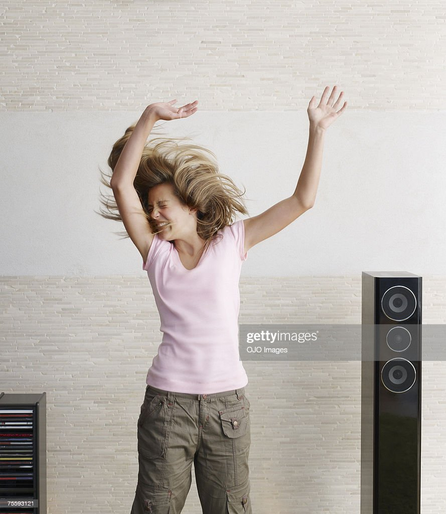 Young girl playfully jumping : Stock Photo