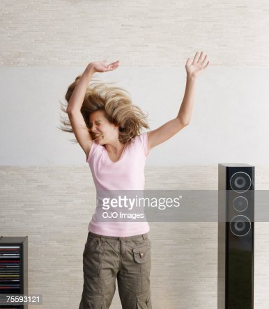 Young girl playfully jumping : Stockfoto