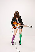 Young girl playing an electric guitar