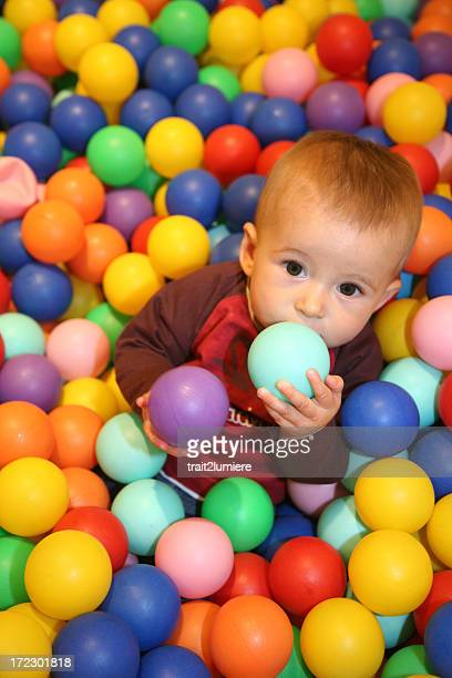 Young girl playing in a ball pool
