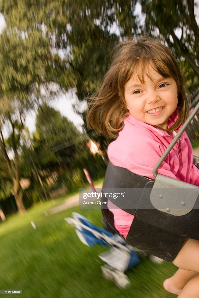 Young girl (age 4) playing in playground, Toronto, Ontario, Canada. : Stock Photo