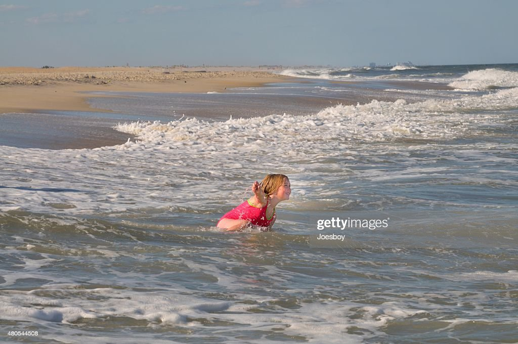 Young Girl Playing In Surf : Stock Photo