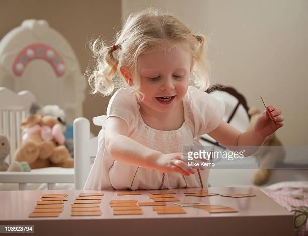 Young girl playing memory game