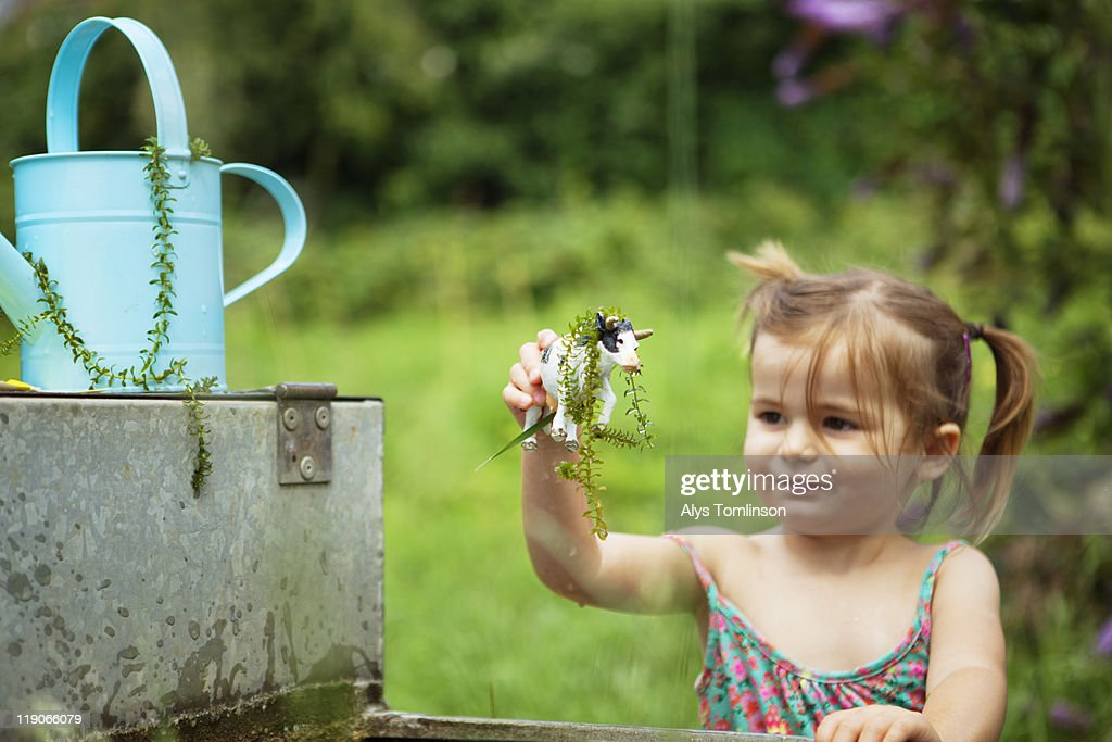 Young girl playing outdoors with toy : Stock Photo