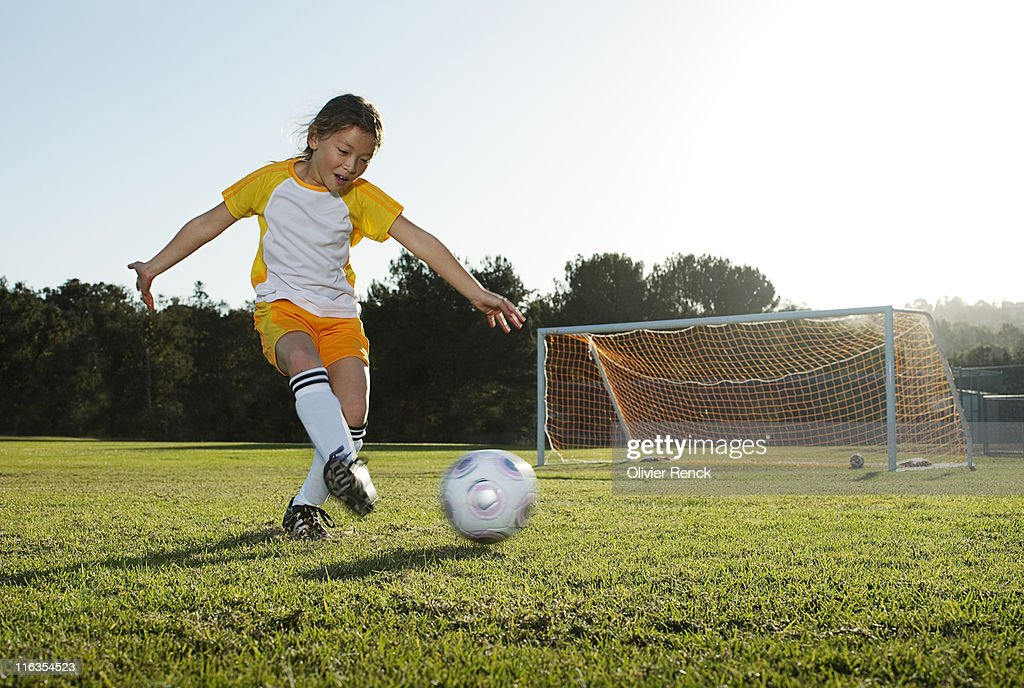 A young girl playing soccer on a soccer field in Los Angeles, California. : Stock Photo