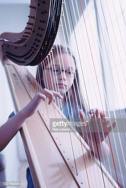 Young girl playing the harp