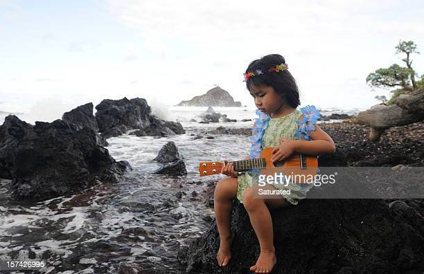 Young Girl Playing Ukelele on Hawaiian Shoreline