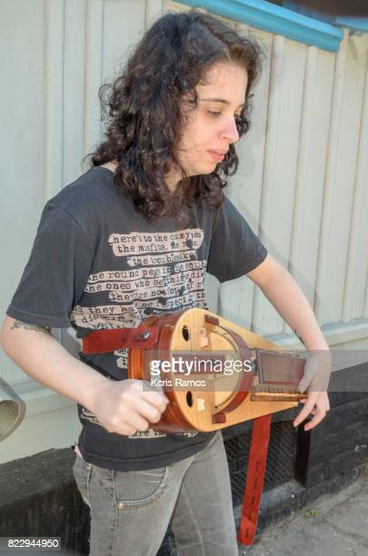 Young girl playing Wheel alley a Swedish instrument,
