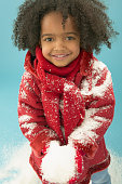 Young Girl Playing with Snow