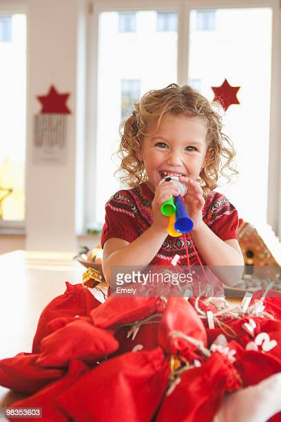 young girl playing with toy gifts