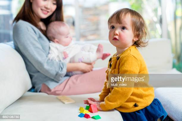 Young girl playing with toys at home