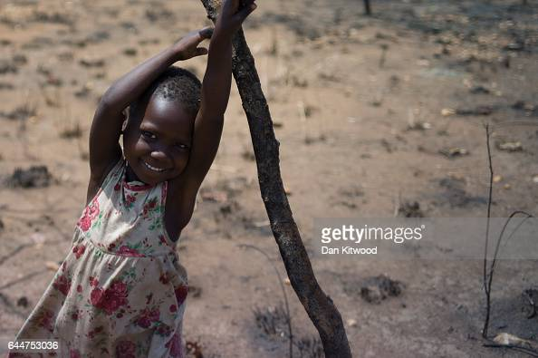 A young girl plays at the Imvepi Settlement on February 23 2017 in Imvepi Uganda The continuing flow of refugees from South Sudan is putting pressure...