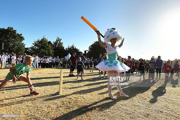 A young girl plays backyard cricket during the Opening Ceremony ahead of the ICC 2015 Cricket World Cup at Hagley Park on February 12 2015 in...